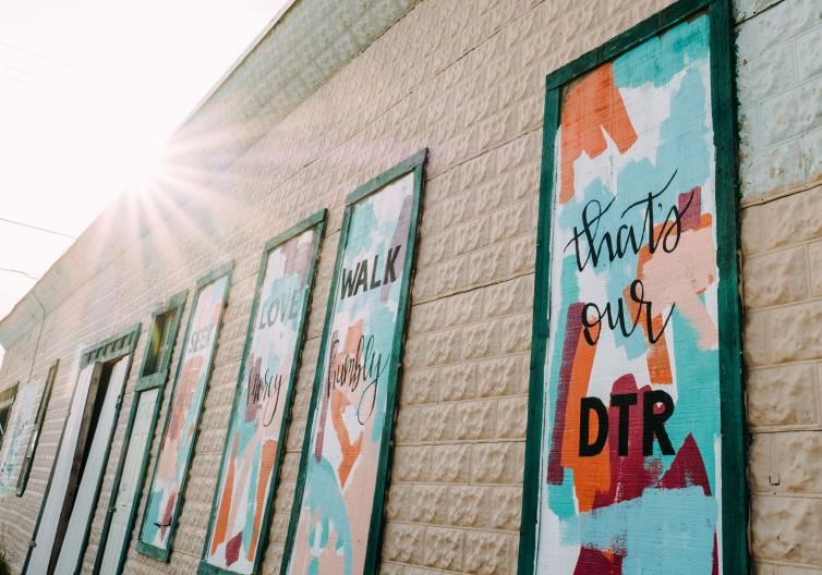 Discover local art in downtown by taking pictures at one of our many murals